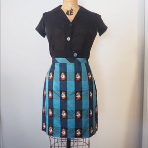 Anthro plaid mini skirt w/floral embroidery